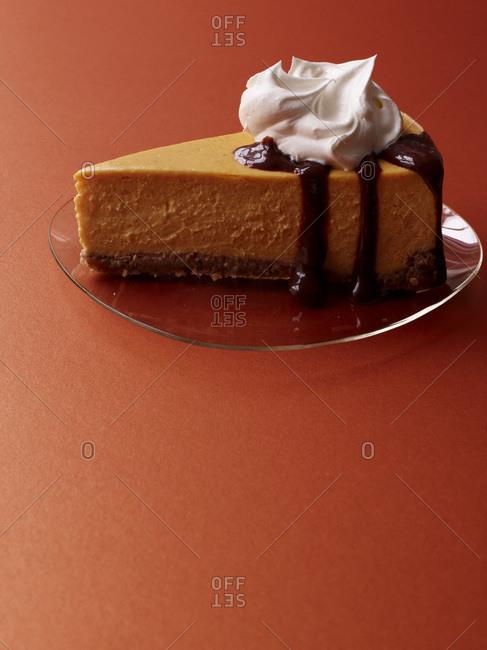 Pumpkin cheesecake with bourbon-spiked cream
