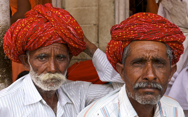 Rajasthan India - April 18, 2012: Rajput men in a street market in a village