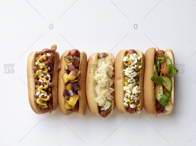 Five hot dogs with different garnishes