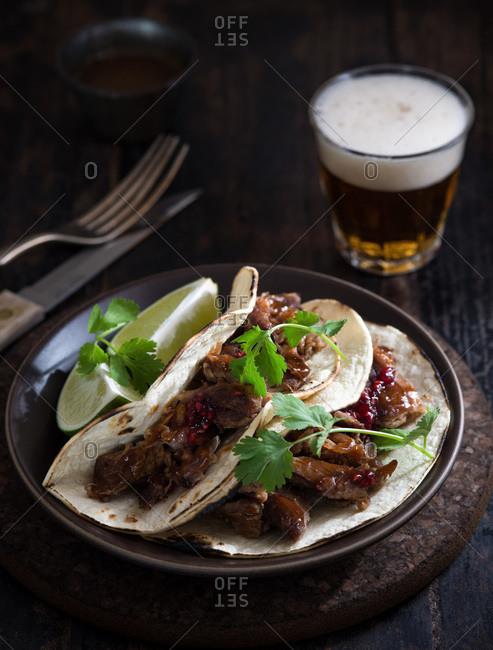 Shredded pork tacos with raspberry habanero jam