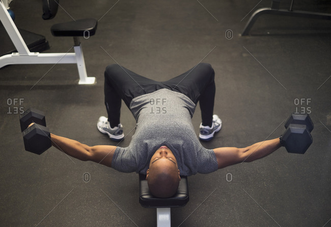 Man lifting weights in gym