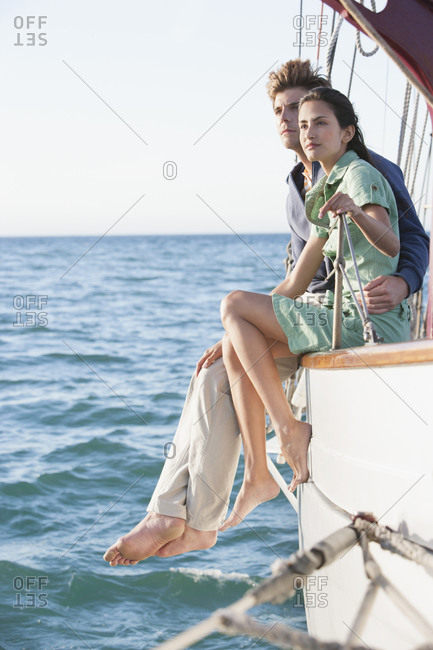 Couple relaxing on sailboat