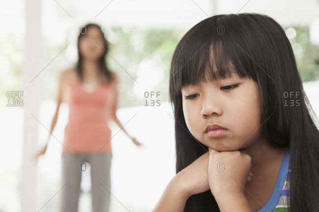 Girl sitting with chin in hands