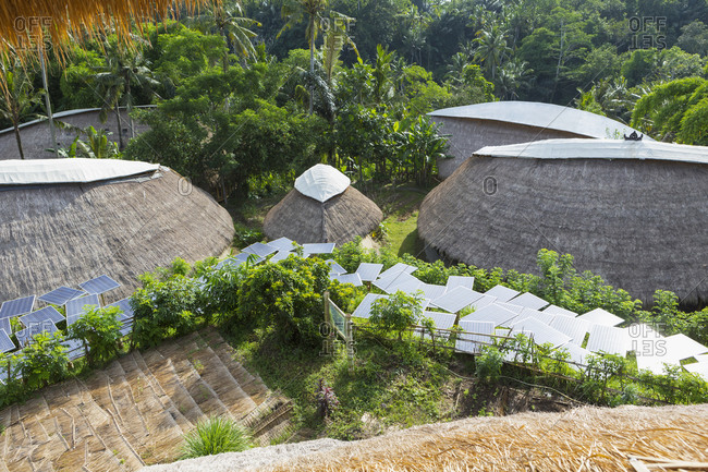 Solar panels among thatched roof buildings