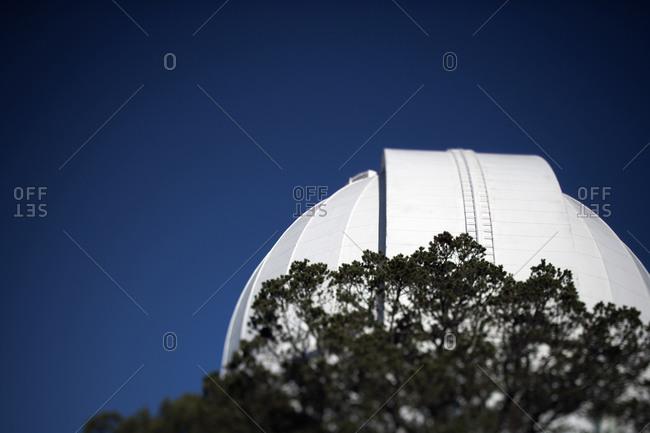 Observatory telescope under blue sky