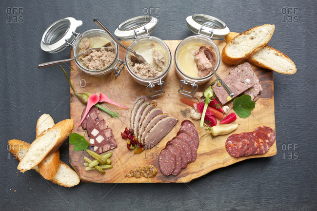 Charcuterie board with pickles and bread