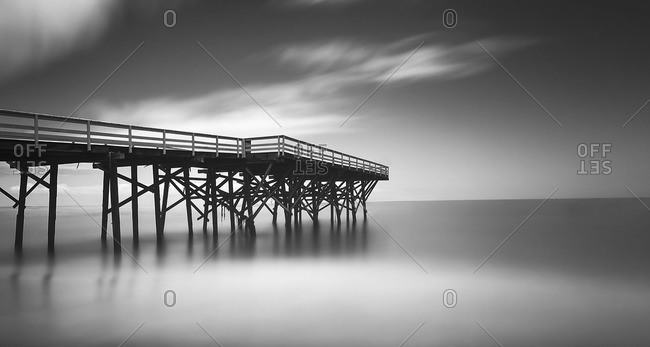 Pier in foggy weather