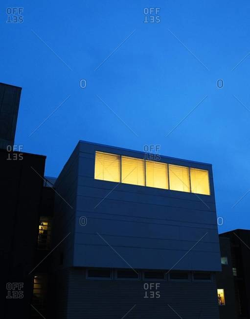 Lit up windows of a building at night