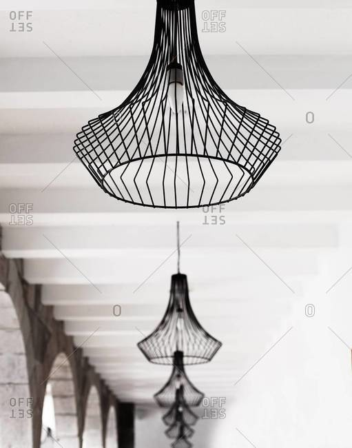 Chandeliers hanging from a ceiling