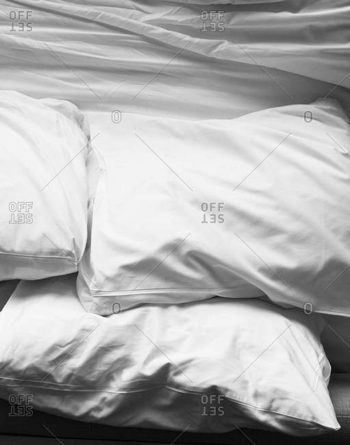 Pillows on a crumpled bed