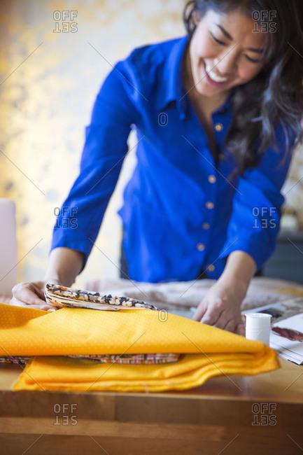 Fashion designer matching fabric at work