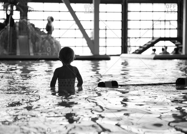 Girl standing in a swimming pool