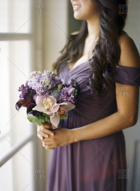 Bridesmaid in dress with flowers
