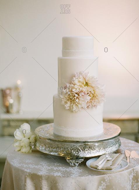 Layered wedding cake on silver platter