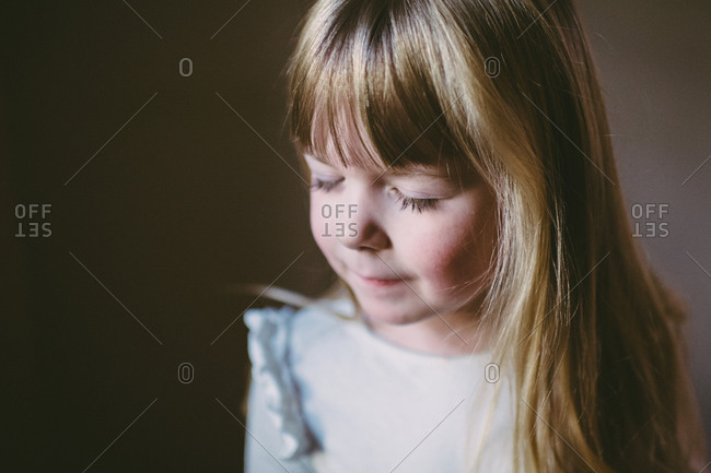Young girl making a wish