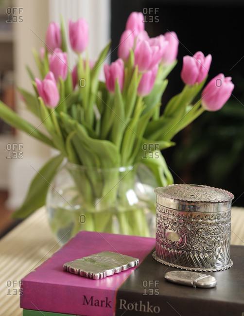 Pink tulips in round vase