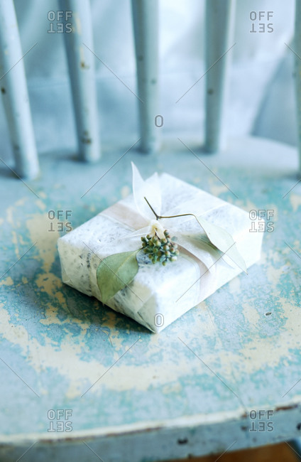 Wrapped gift box on a chair