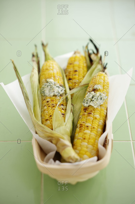 Grilled corns served with herbed butter