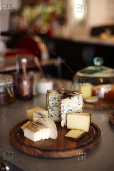 Fiore Sardo, Valdeon and Garrotxa cheeses on a platter