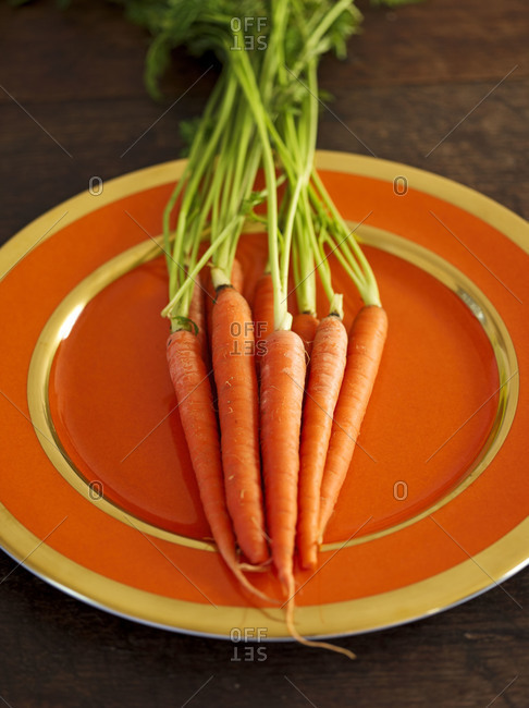 Close up of fresh carrots on a plate