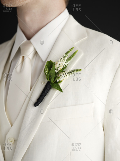 Close up of a boutonniere on a man's jacket