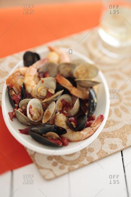 Bowl of fresh seafood on table
