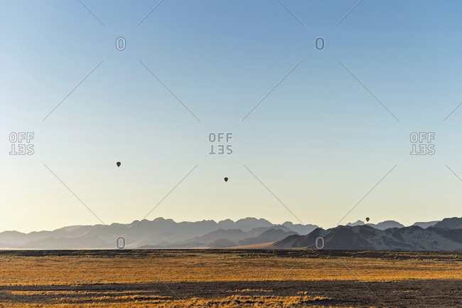 Three hot air balloons floating over the desert, Sossusvlei, Namibia, Africa