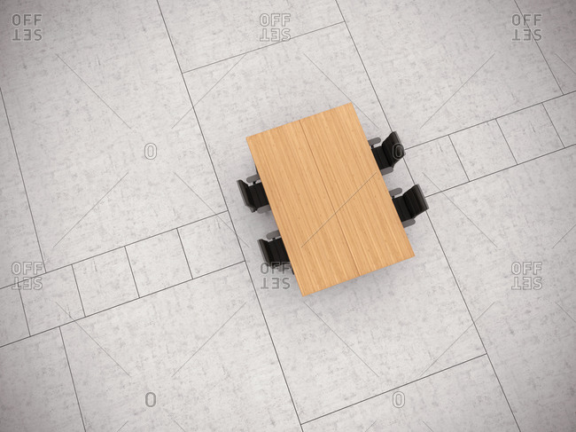 Conference table and four office chairs on concrete floor, 3D Rendering