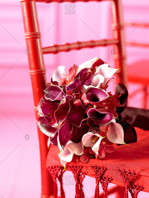 Bouquet of calla lily on a red chair