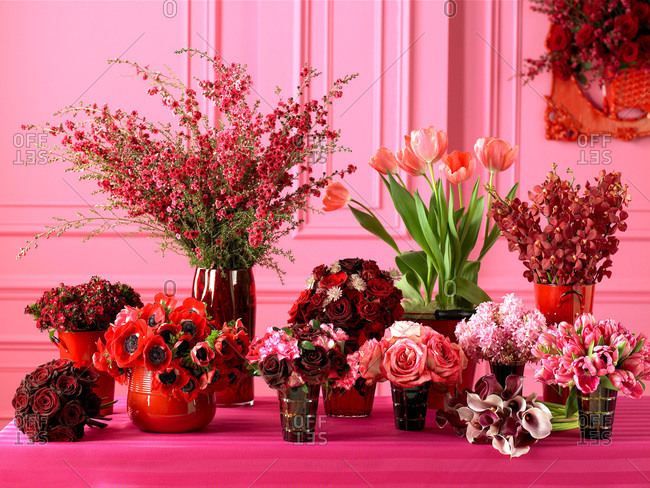 Pink and red flower bouquets placed on a table