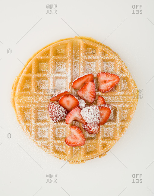 Waffle with strawberries and dusted confectioner's sugar