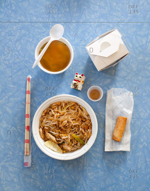 Pad thai noodles, soup and deep-fried spring roll