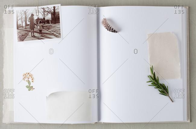 Opened scrapbook with mementos - Offset