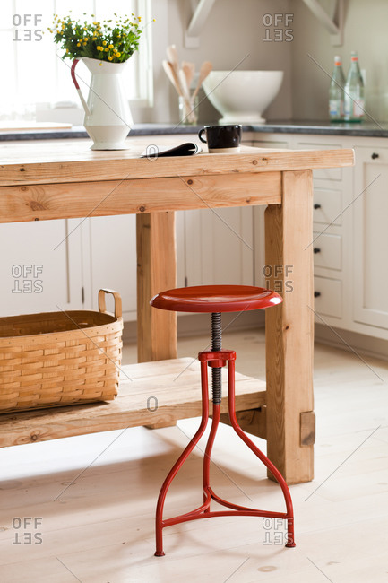 Red swivel bar stool in the kitchen