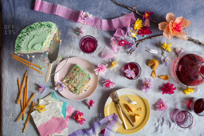 Birthday party cake on a messy colorful table