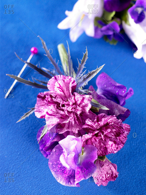 Purple boutonniere from the Offset Collection