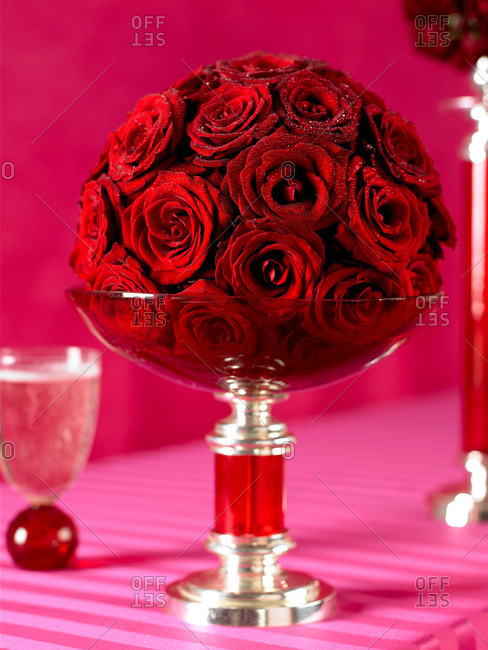 Glass bowl of deep red roses