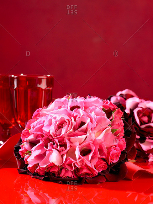 Pink flowers on a red table
