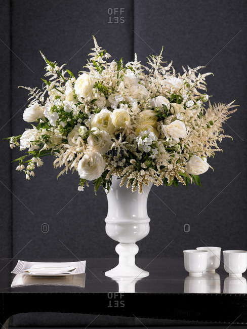 White vase of white flowers