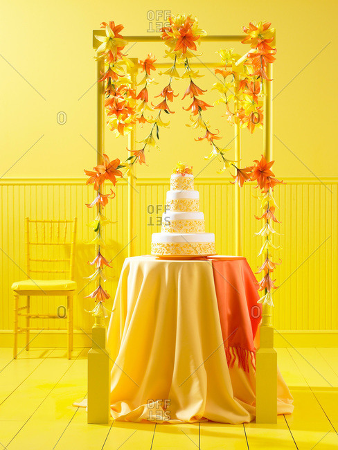 Tiered wedding cake in yellow room
