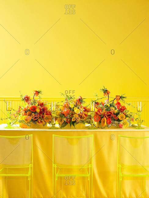 Yellow and orange centerpiece on yellow table