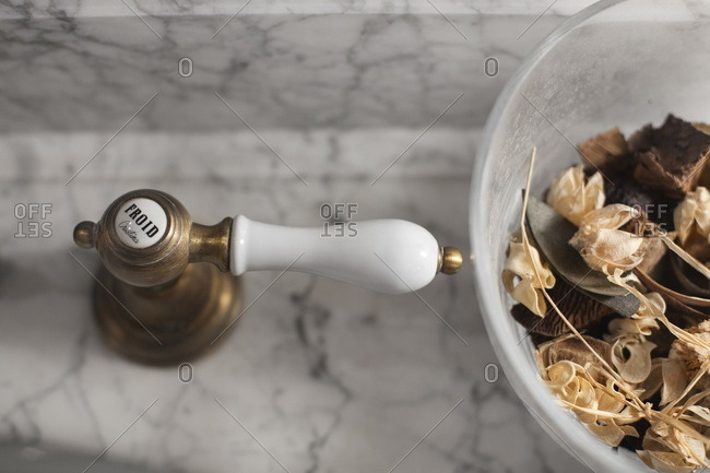 Cold water tap next to potpourri