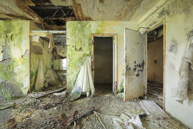 A hotel room in severe disrepair