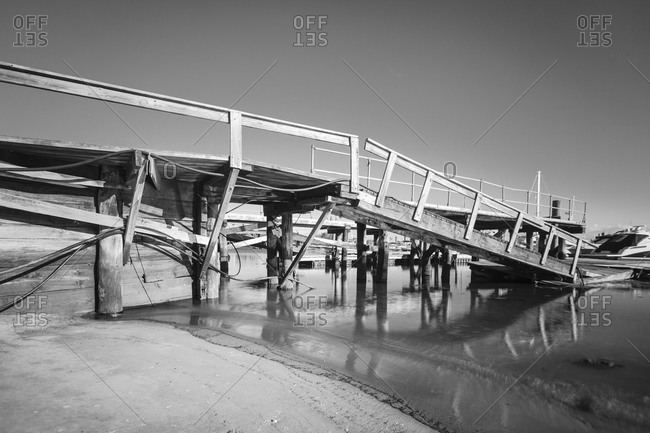 Wooden pier broken in half