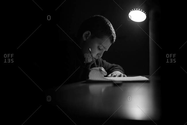Boy writing his homework
