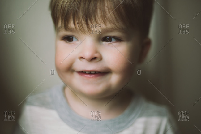 Smiling toddler with chubby cheeks
