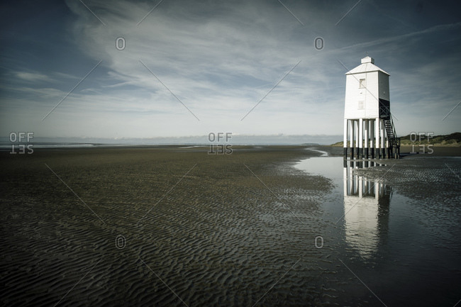 Wooden lighthouse on the beach in Burnham-On-sea