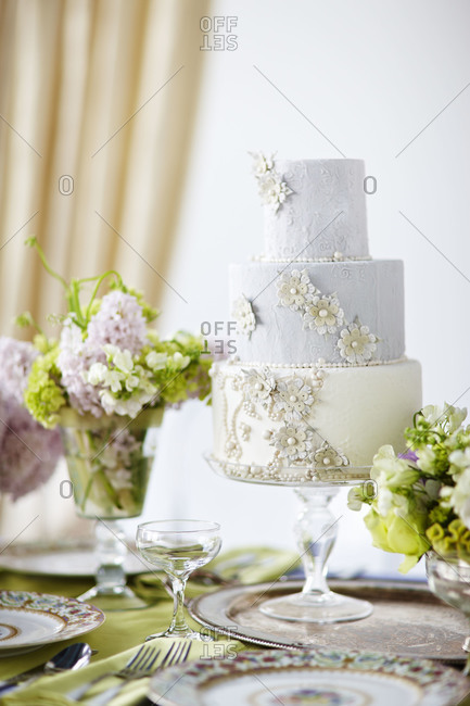 Three-tiered wedding cake with floral decoration