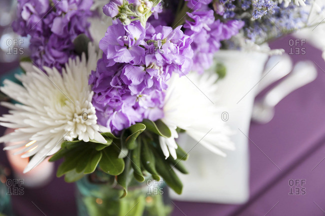 Purple and white flower bouquet at wedding venue