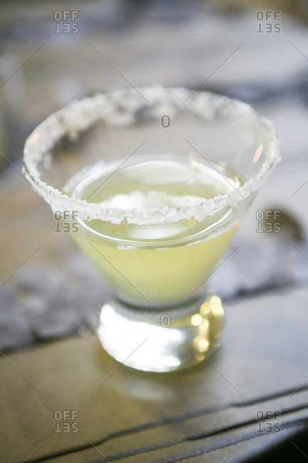 Rimmed margarita cocktail served on a table